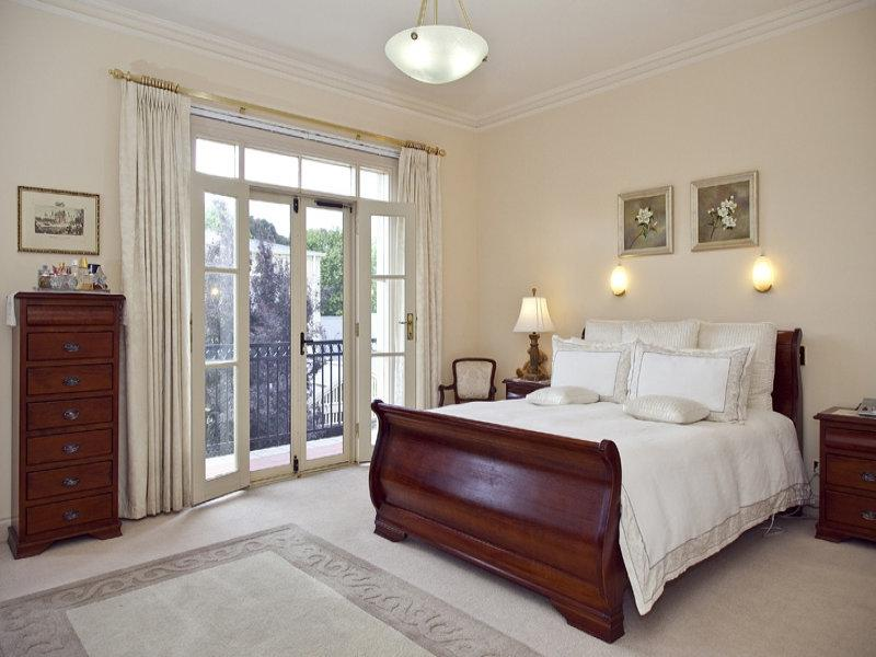 Classic bedroom design idea with carpet  french doors using brown...