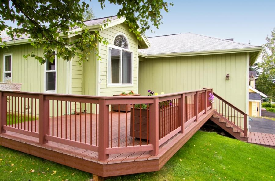 Extend your front porch entryway with a deck that makes a...