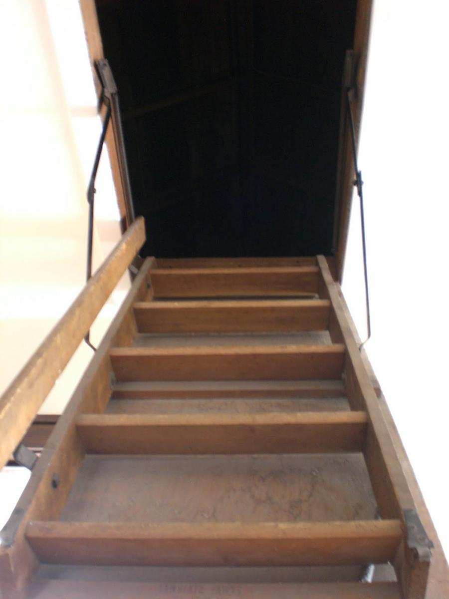 We have a full size attic, complete with pull-down stairs. Well,...