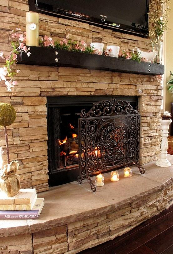 white stacked stone fireplace ...