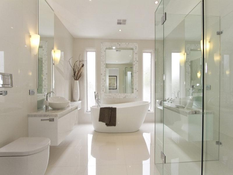Modern bathroom design with freestanding bath using frameless...