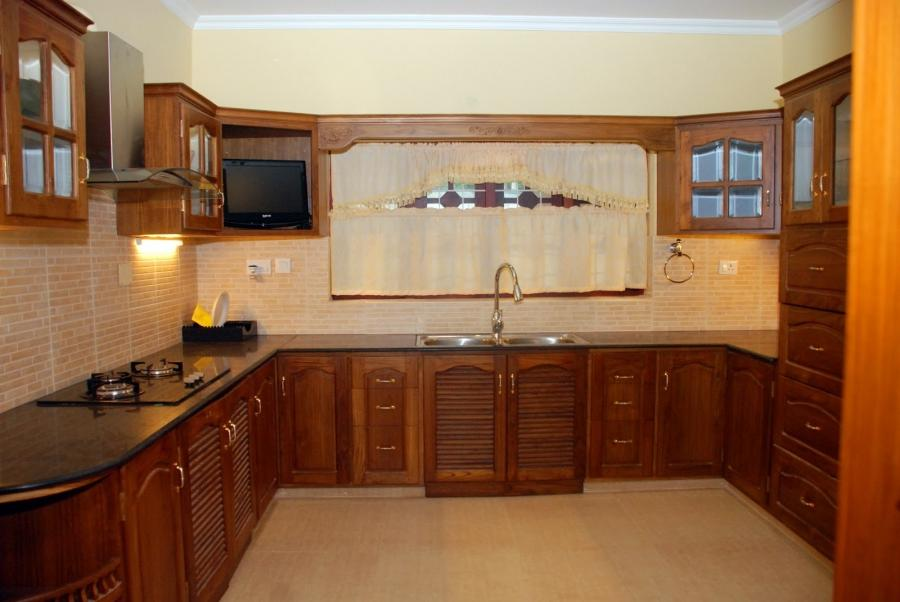 Kitchen cabinets photos kerala for Kitchen cabinets kerala