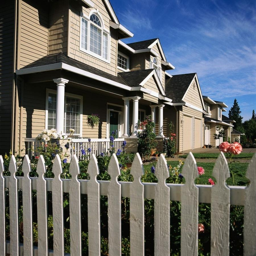 House With White Picket Fence Photo