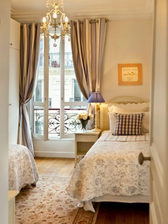 The large French door in the second bedroom is elegantly draped...