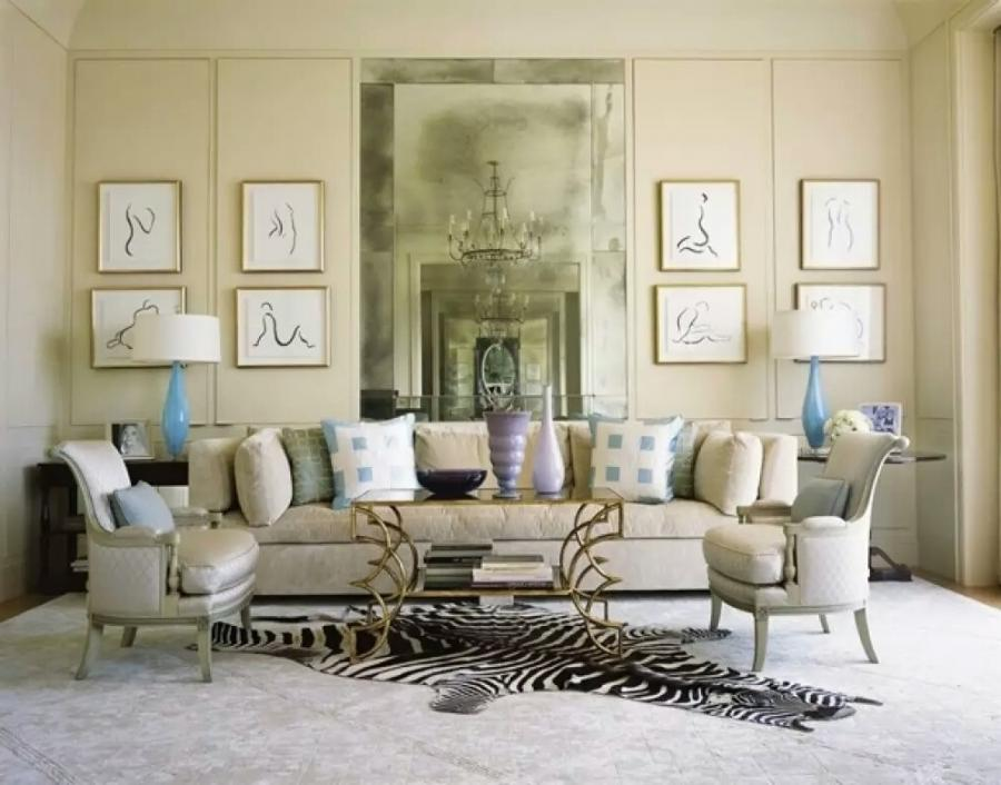 French interior design living room with sofa mirror wall...