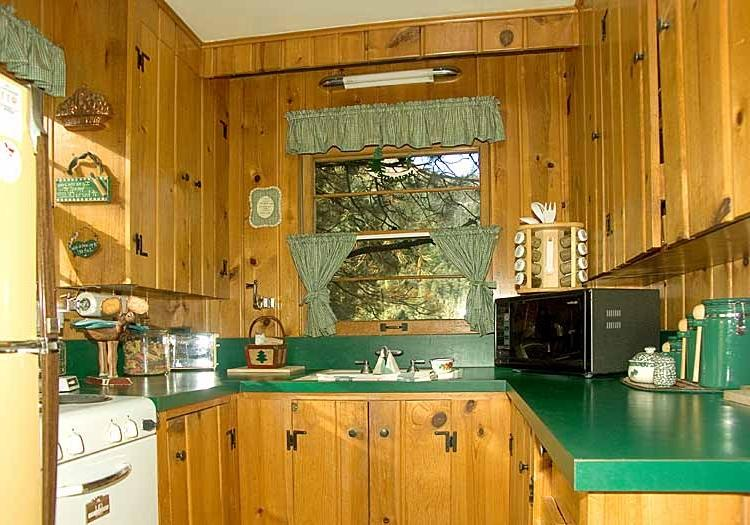 Cabin-kitchen-with-U-shape-furnished-with-wooden-