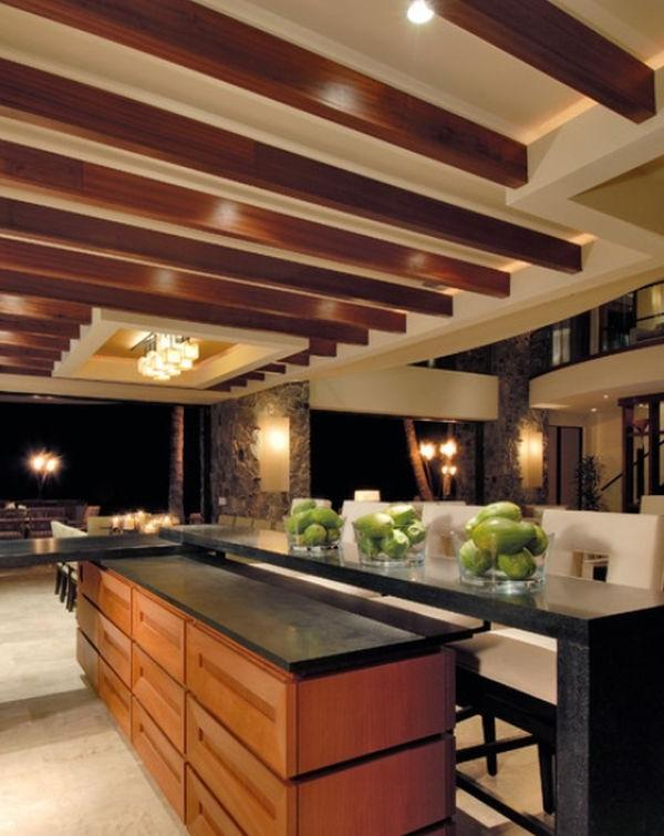 A series of brown beams on a simple, beige tray ceiling is also a...