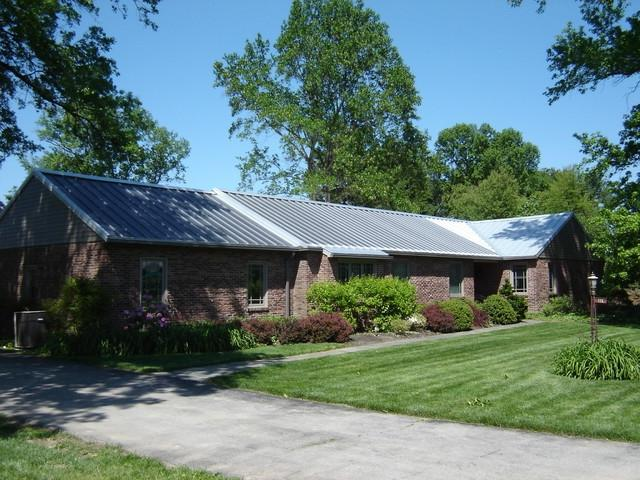 Photos brick ranch roof for Metal roof ranch house