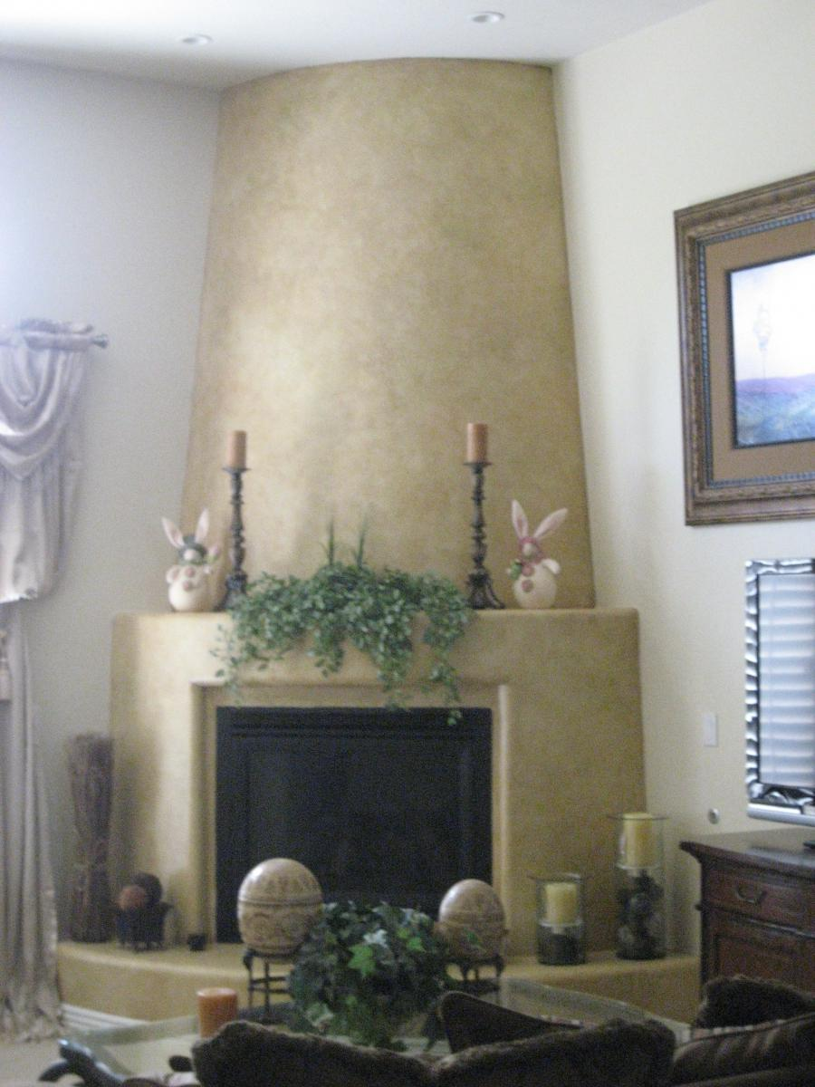 Adobe fireplace photos for Bella villa interior design