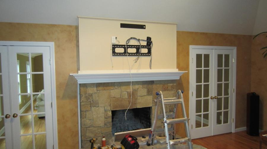Photo tv above fireplace Kitchen design newtown ct