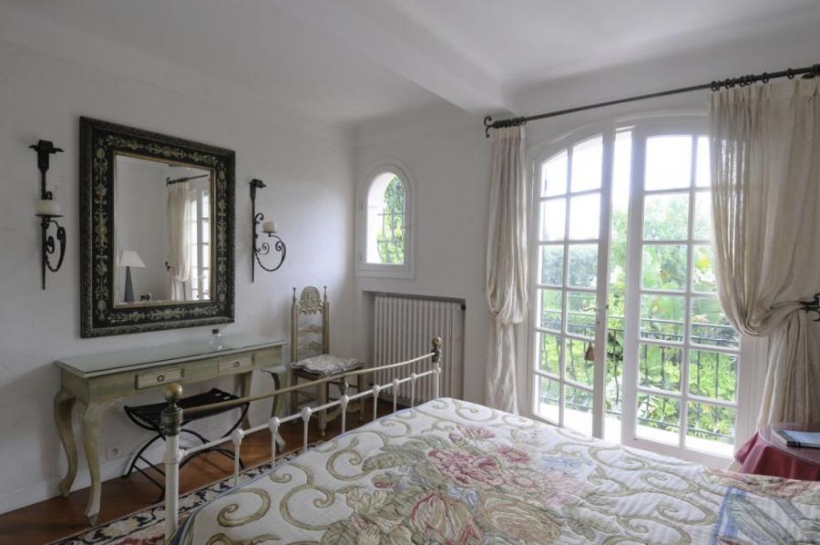 Bedroom With Wooden Dressing Table In Traditional French Country...