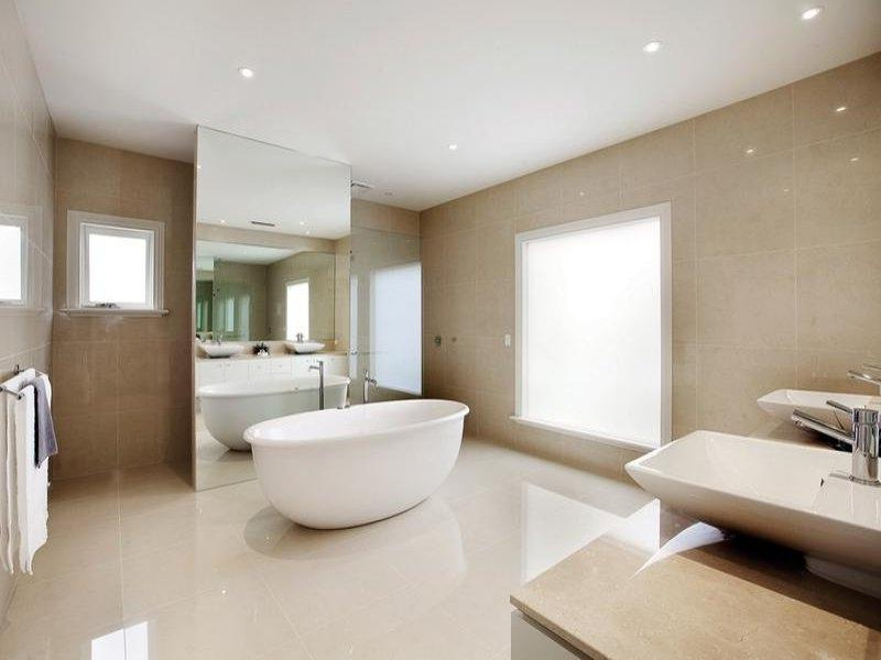 French provincial bathroom design with twin basins using ceramic...
