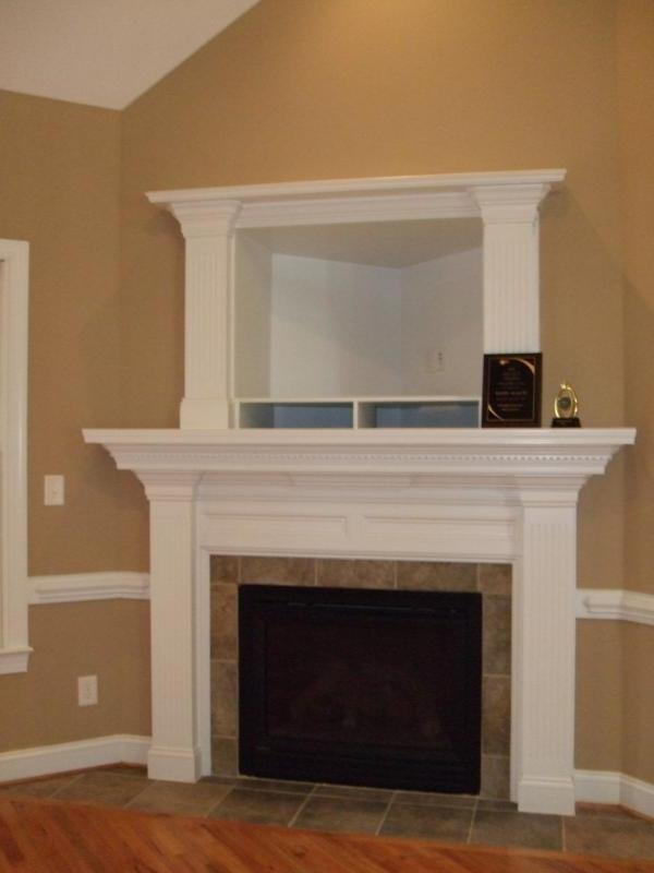 Flat screen tv over fireplace photos for Tv and fireplace layout