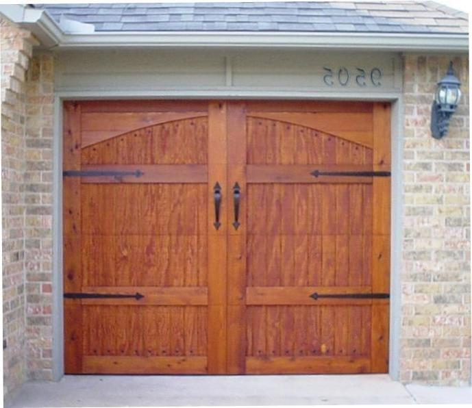 Wood garage door photos for Wood veneer garage doors