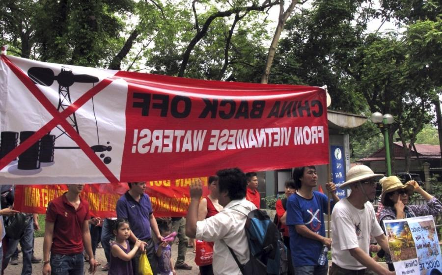 Vietnamese protest outside the Chinese Embassy in Hanoi, Vietnam...