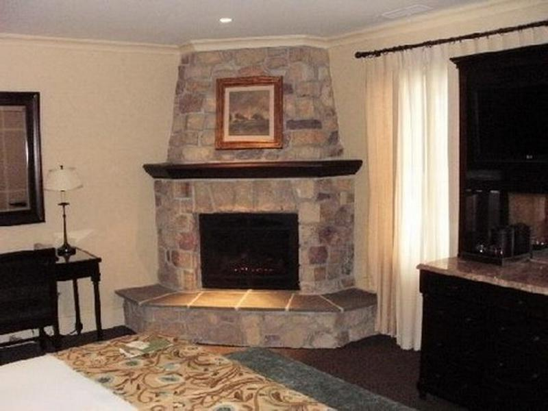 Photos of corner stone fireplaces Corner rock fireplace designs