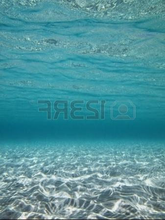 Stock Photo - Underwater lights reflected on a sandy sea floor in...