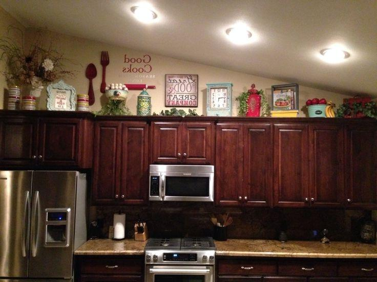 Decorating above kitchen cabinets photos How to decorate the top of your kitchen cabinets