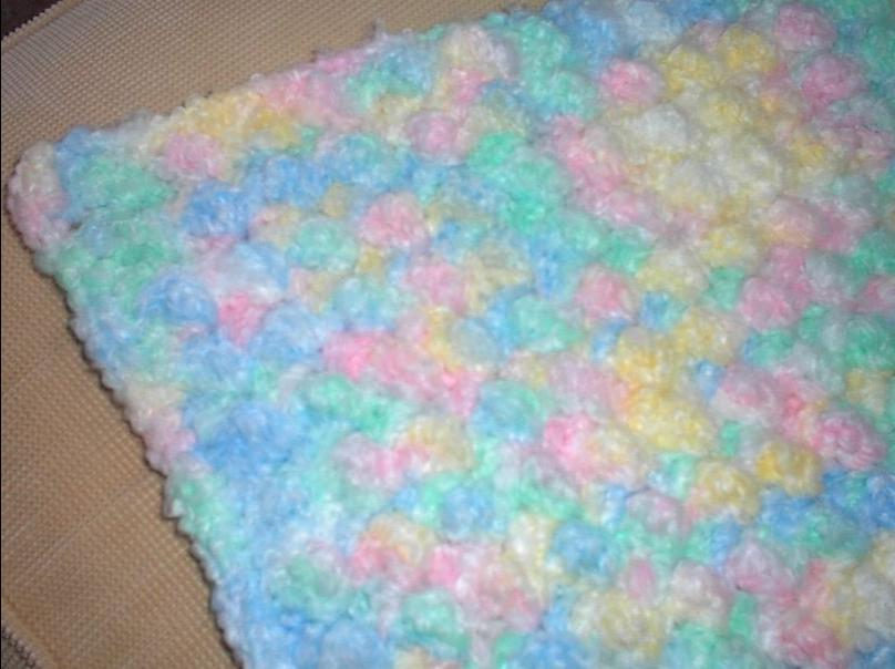 This is a very thick cozy baby blanket I crocheted before one of...
