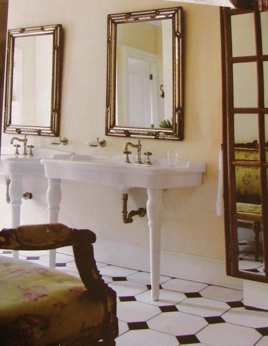 The main bathroom with matching French porcelain basins....