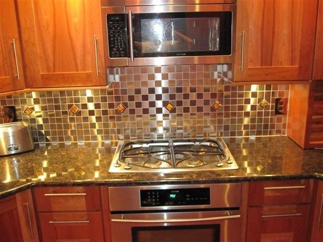 photos of glass tile on backsplash in kitchen