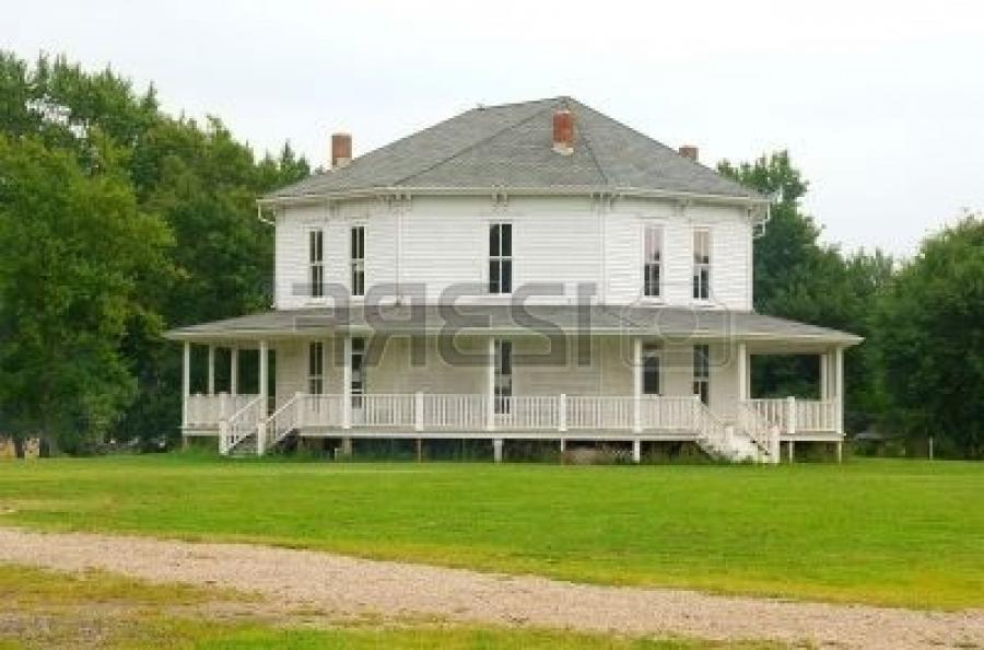 Stock Photo - White Octagonal Farmhouse - an old country...