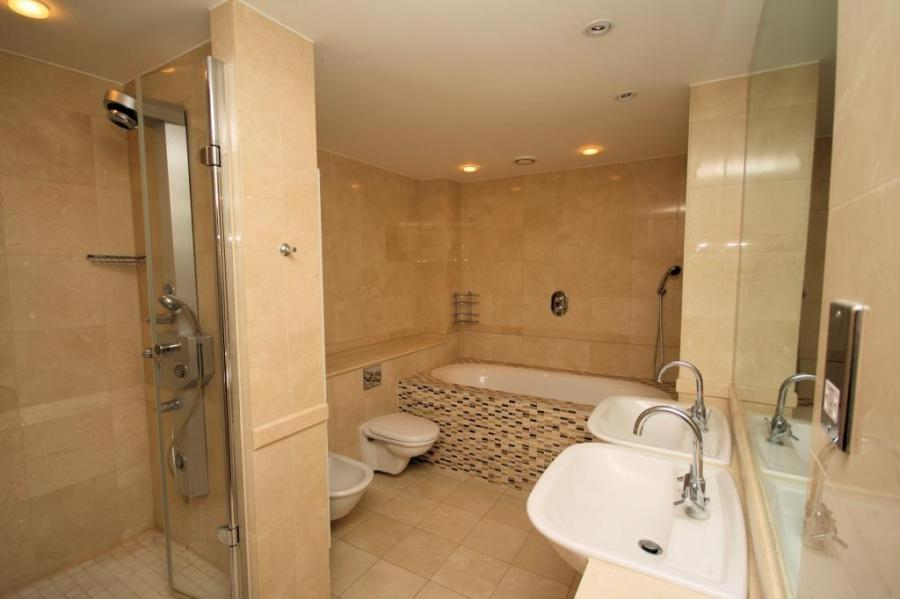 photo of beige stone bathroom with tiles mosaic
