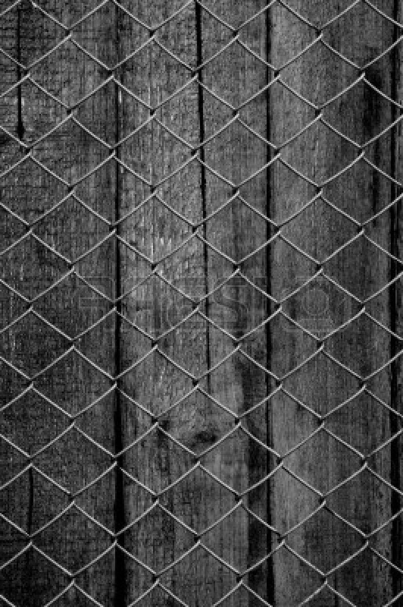 Stock Photo - chain link fence see old wooden background