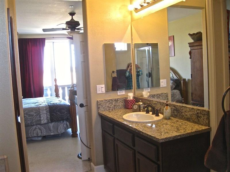 Master Bath - gorgeous dark wood cabinets and granite with...