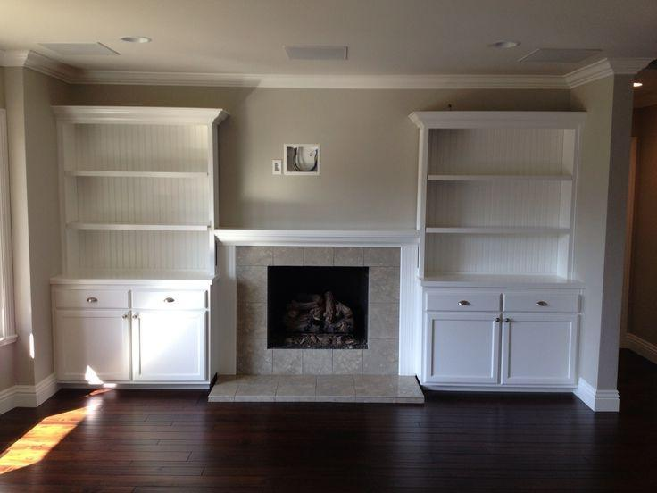 Built in shelves around fireplace photos