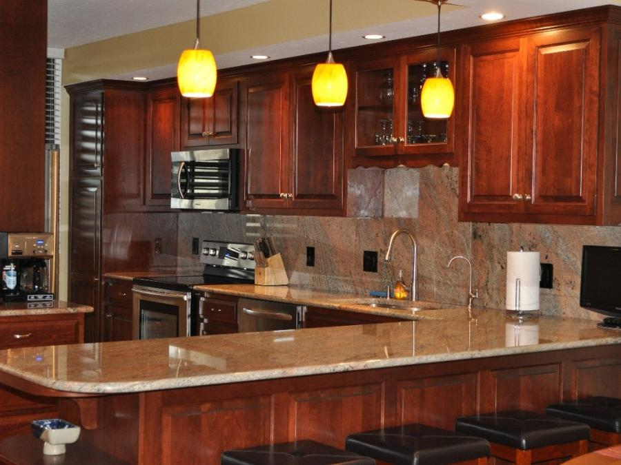 Photos of finished kitchens with cherry kitchen cabinets for Cherry wood paint for kitchen cabinets