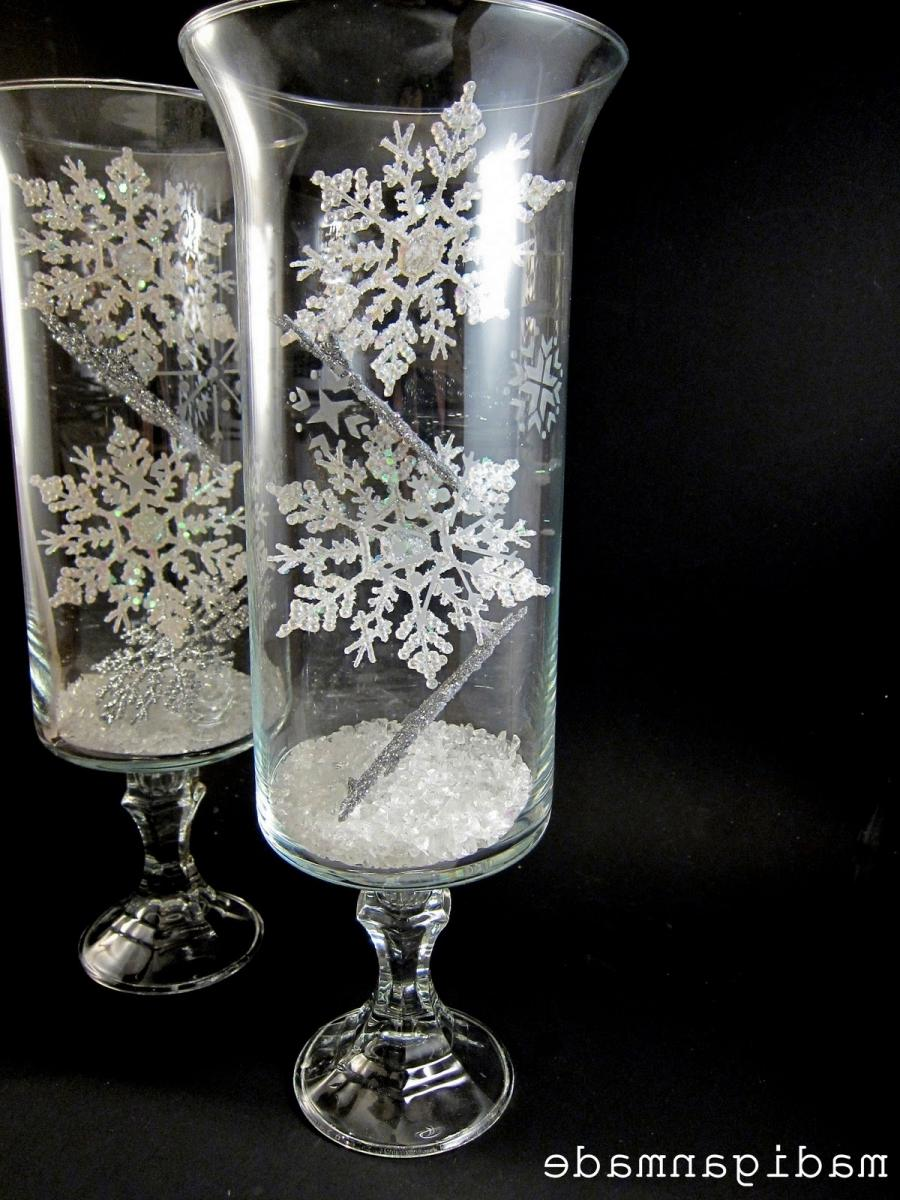 Snowflake-etched glass hurricane vases