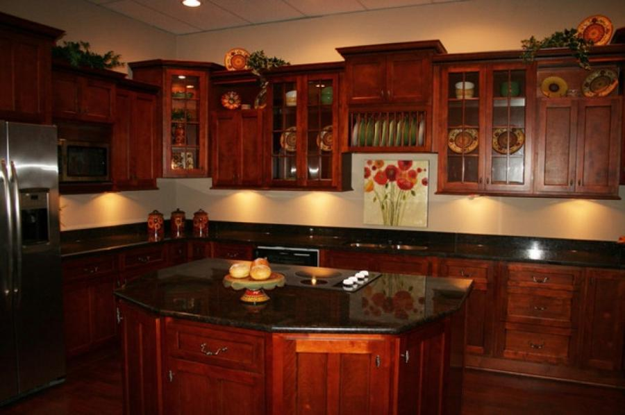 Cherry cabinets black granite photos for Cherry red kitchen cabinets