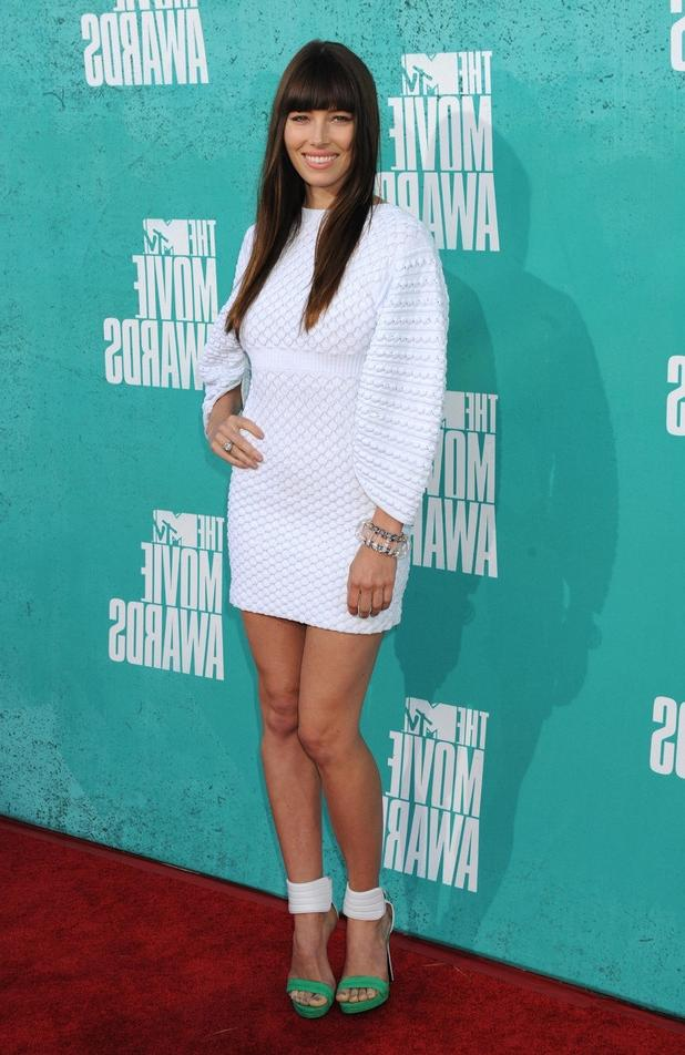 Previous Next Jessica Biel on the red carpet at the MTV Movie...