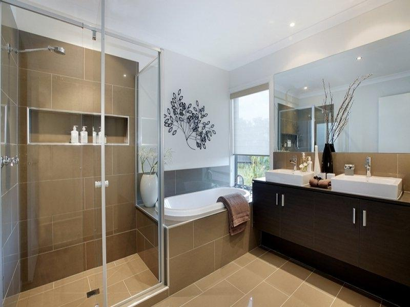 Asian-inspired bathroom design with built-in shelving using tiles...