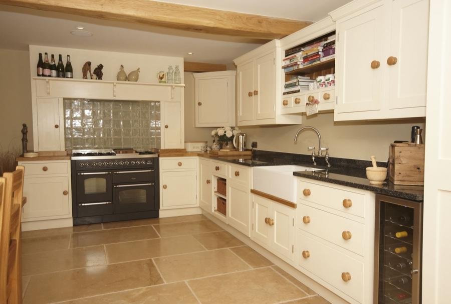 tempered glass backsplash plus white sink and wooden cabinets on