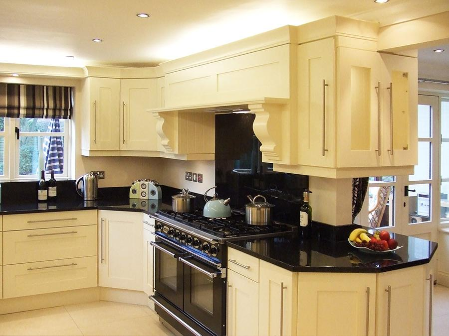 Cream colored kitchen photos for Butter cream colored kitchen cabinets