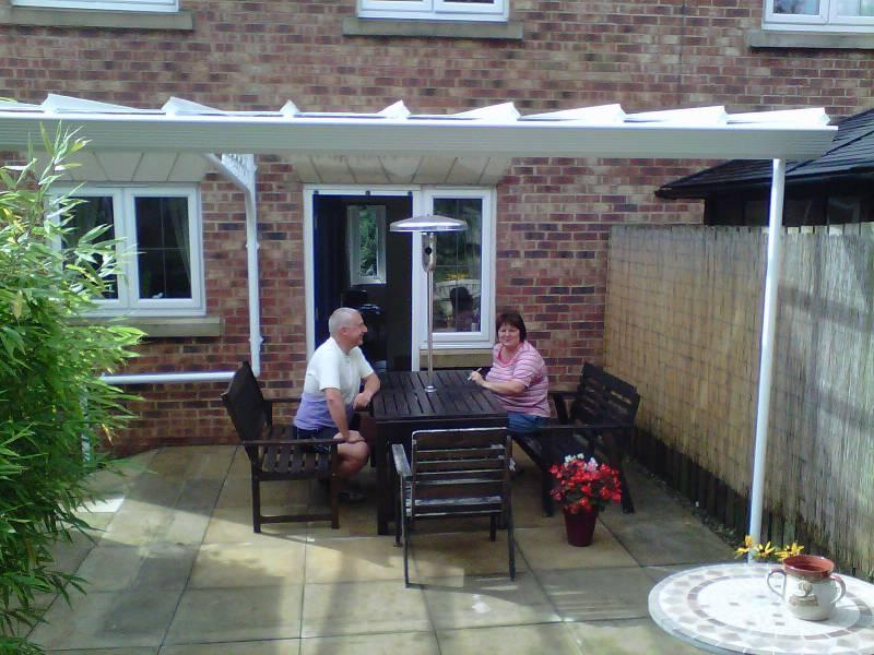 A happy customer tries out their new glass veranda u0026middot;...