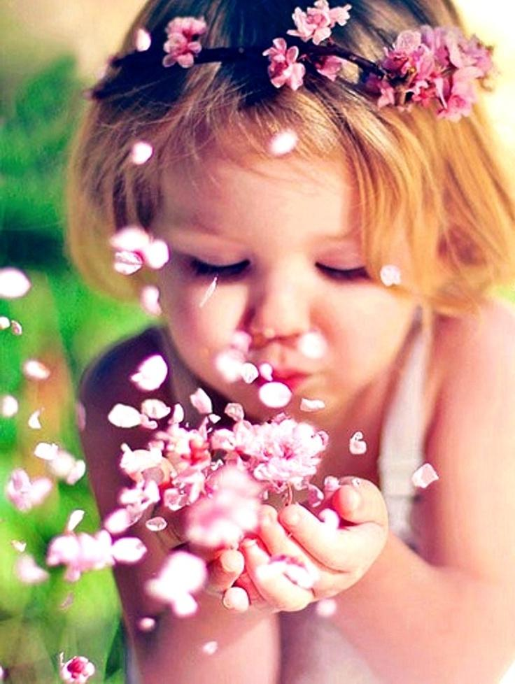 Cute baby with flowers photos