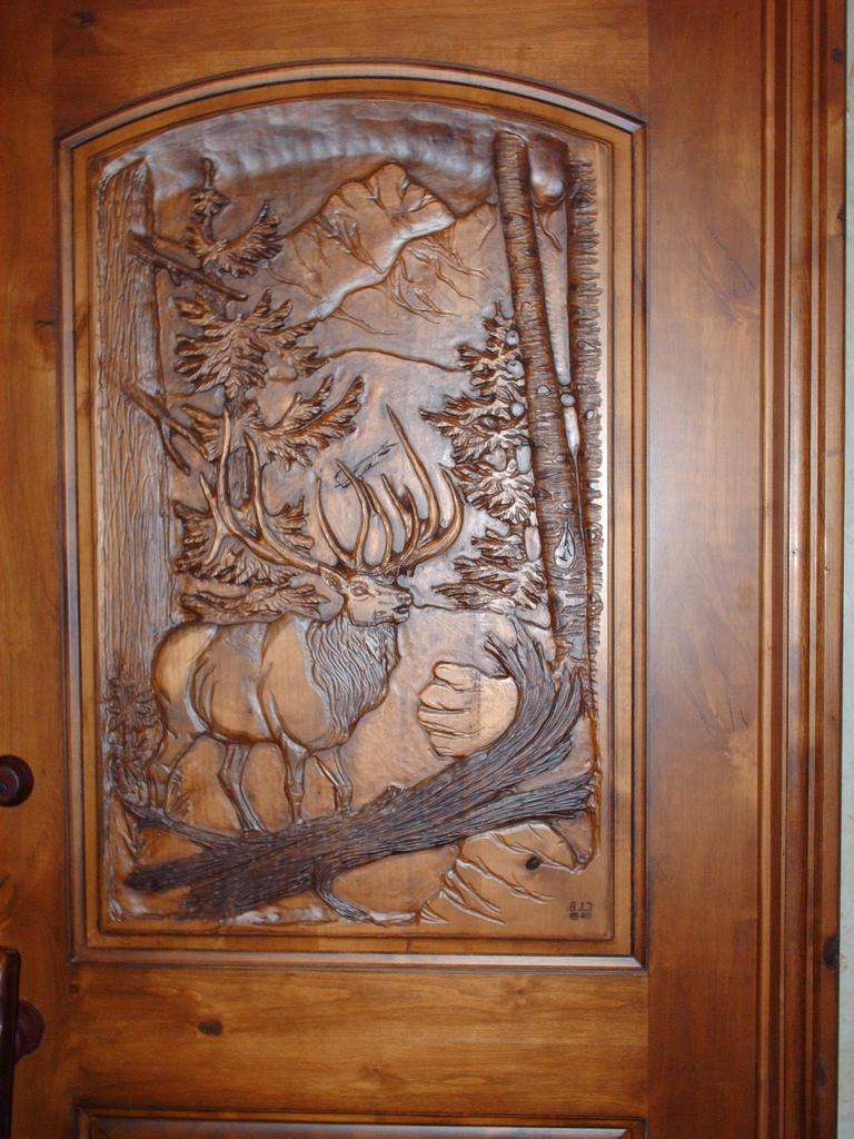 Wood carving door photos for Hand carved wood doors