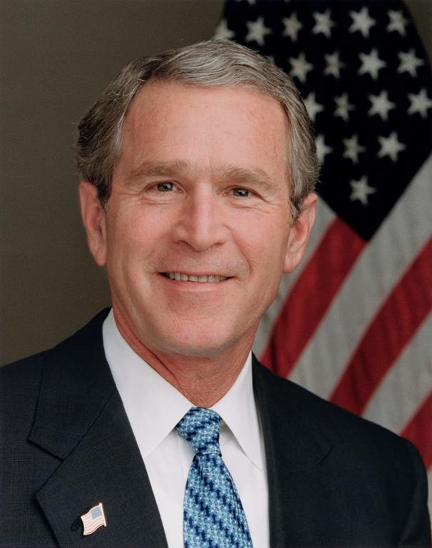 President George W. Bush poses for his official portrait in the...