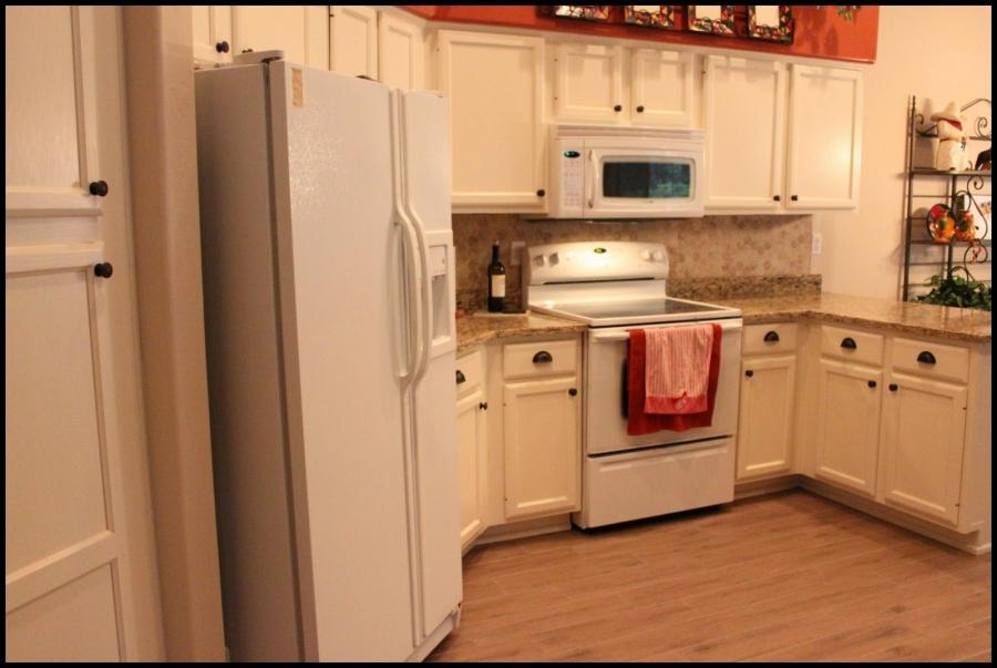 Photos of before and after refinished kitchen cabinets for Oak kitchen cabinet refinishing