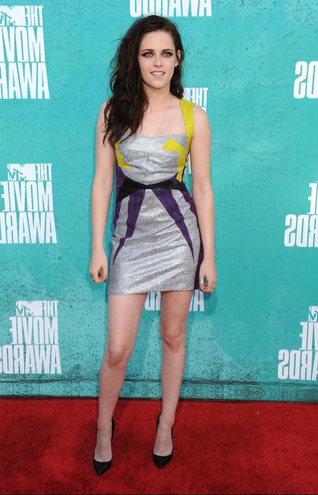 Previous Next Kristen Stewart on the red carpet at the MTV Movie...