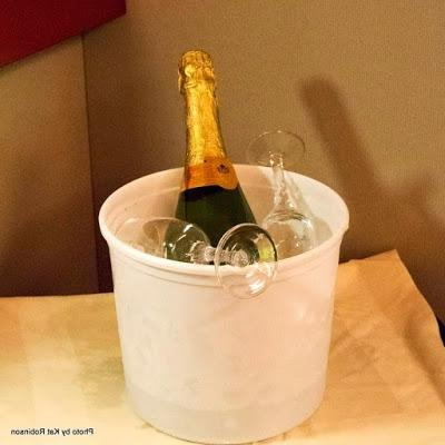 The bucket may not be fancy, but champagne on ice with glasses is...