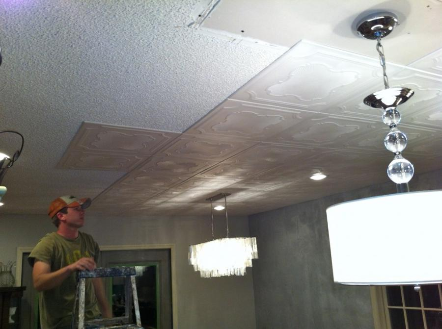 Styrofoam ceiling tiles glue right on top of popcorn ceilings