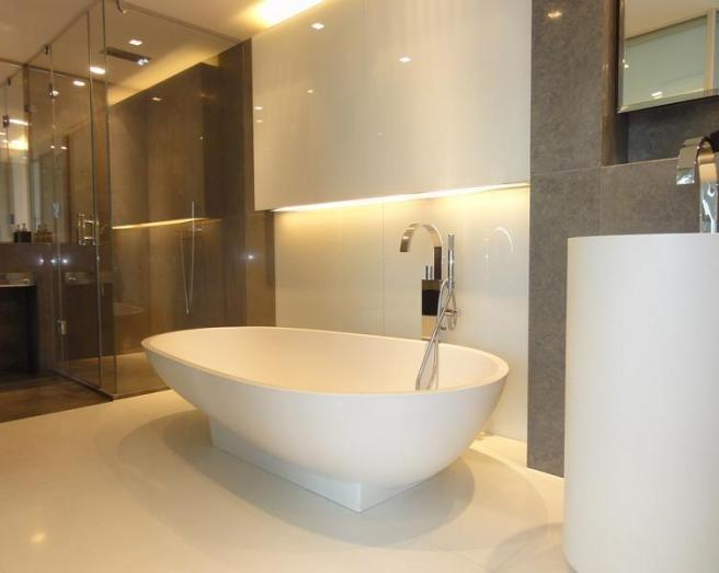 photo of contemporary modern beige brown white bathroom