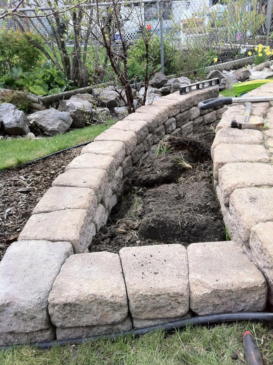 Building a stone wall on a slope is quite simple if you have two...