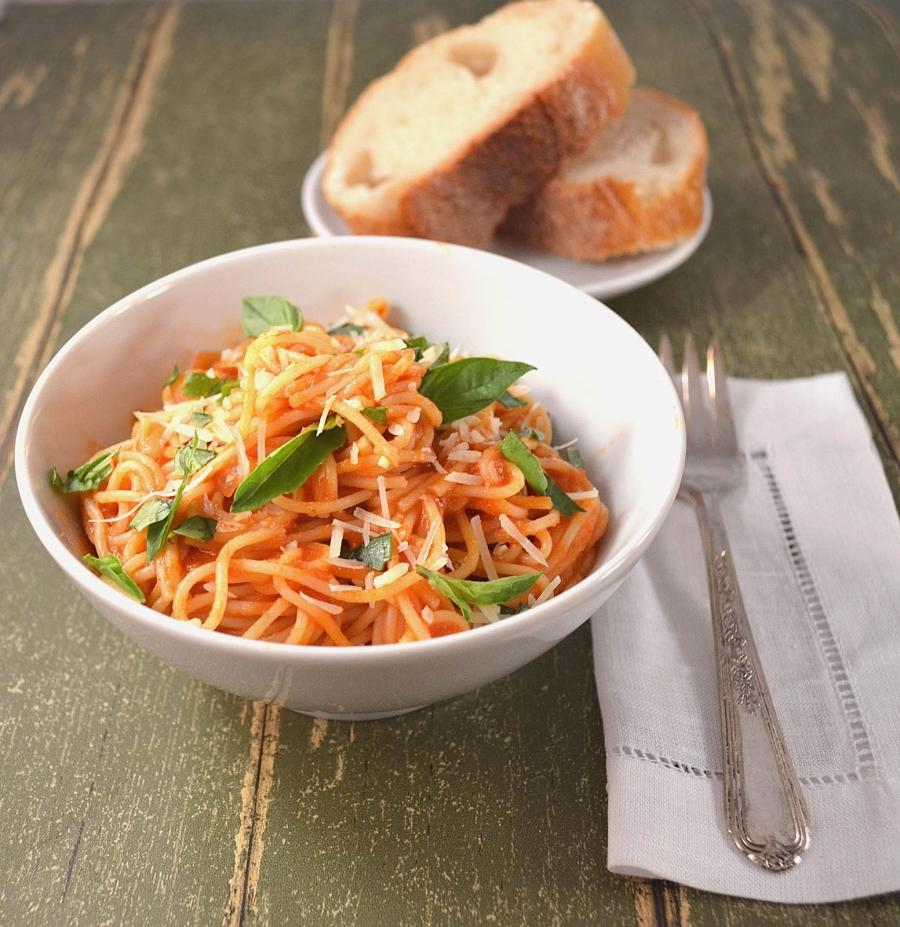 Angel Hair Pasta in a Light Tomato Cream Sauce with Fresh Basil