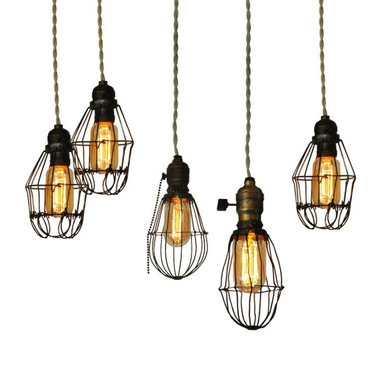 Three metal cage lights from 1915-1920s. Shown with Edison bulbs....