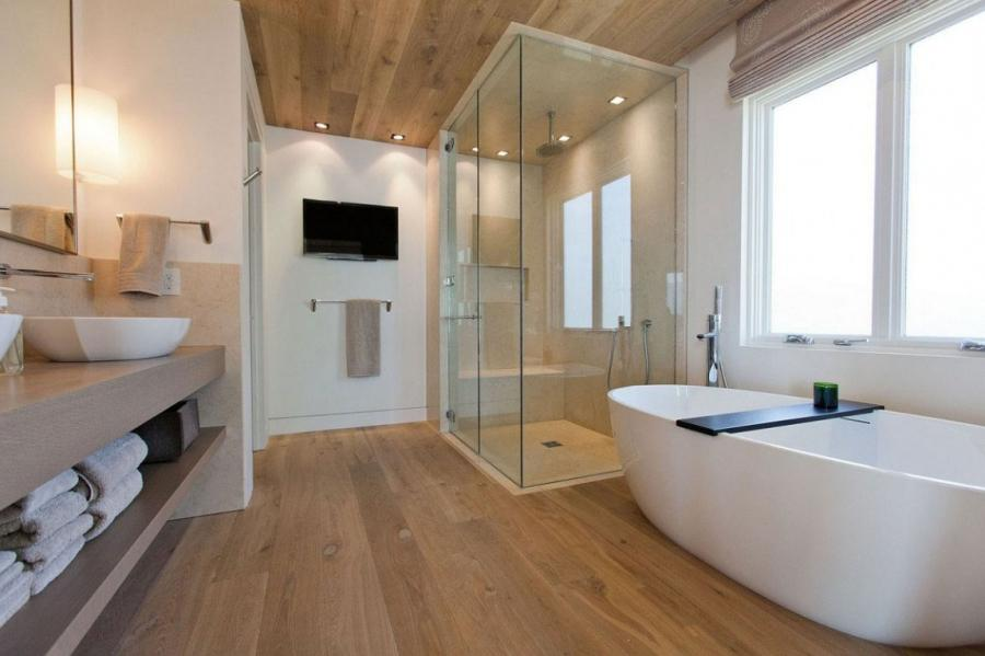 Moving on to a more minimalist bathroom design, this warm and...